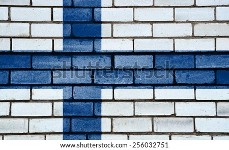 Finland flag painted on old brick wall texture background - stock photo