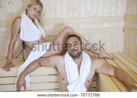 finland sauna warming up and healing in a spa wellness resort cabin with young couple - stock photo