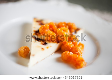 Finnish cheese with fresh cloudberries - stock photo