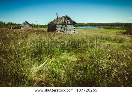 Finnish-Russian sauna village on the river bank - stock photo