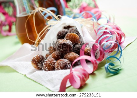 Finnish traditional Vappu food, sugar donuts with sima - stock photo