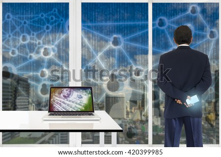 FINTECH concept background. Laptop computer with digital money abstract on its screen against business man looking the city  with digital code outside building. - stock photo