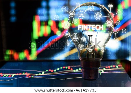 Fintech Investment Financial Internet Technology Concept. Light bulb on tablet and Stock graph and business technology icon with abstract stock graph and electronic circuit background , copy space