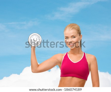 fintess, healthcare and dieting concept - young sporty woman with heavy steel dumbbell
