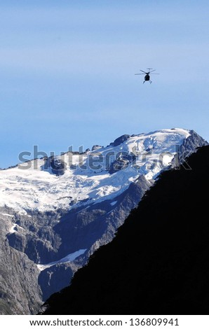 FIORDLAND, NZ- FEB 28:Helicopter fly above Milford Sound on February 28 2009.It's one of the most beautiful parts of New Zealand and the largest of NZ national parks with an area of 12,500 km�².