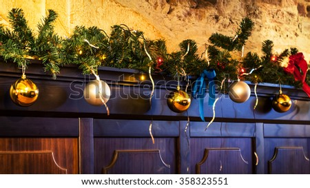 Fir branch and balls decorate wall in christmas - stock photo