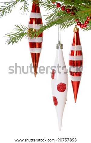 Fir branch with red christmas baubles on white background - stock photo