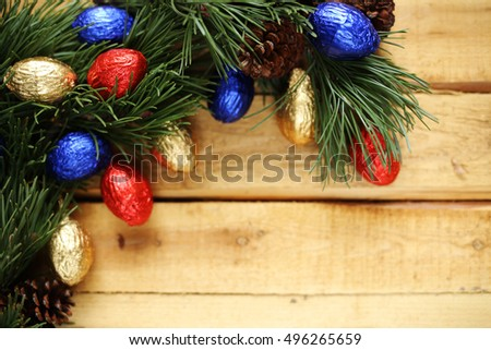 fir branches and chocolate cones on a wooden plank background 4