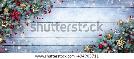 Fir Branches With Baubles On Wooden Plank