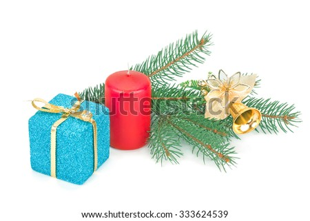 fir branches with golden bell, candles and gift boxes isolated on white - stock photo