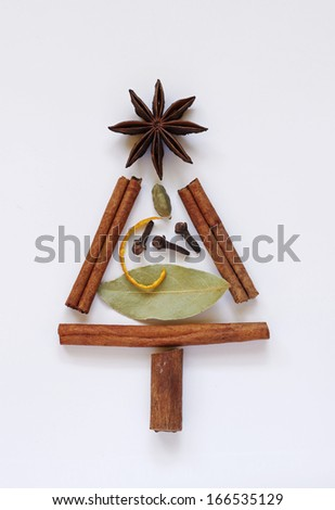 Fir Christmas tree decorative shape made of mulled wine or punch condiments - stock photo