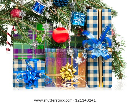 Fir-tree branch with christmas gifts isolated on white background - stock photo