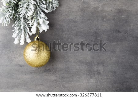 Fir tree covered with snow on gray board. - stock photo
