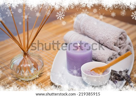 Fir tree forest and snowflakes against spa objects on wooden table - stock photo
