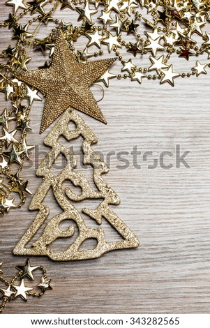 fir-tree with star on wooden background - stock photo
