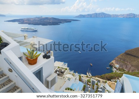 FIRA.GREECE-SEPTEMBER 30,2015: Beautiful architecture of the greek houses and romantic panoramic view on caldera and vulcan.Scenic natural landscape. Santorini (Thira) island.Cyclades.Greece.Europe.