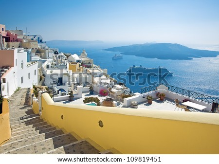 Fira panorama with caldera view and Nea Kameni, Santorini, Greece - stock photo