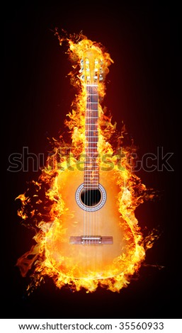 Fire acoustic guitar - stock photo