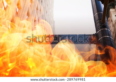 Fire against wall street - stock photo
