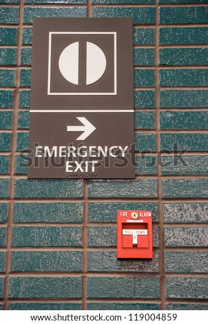 fire alarm and emergency exit - stock photo