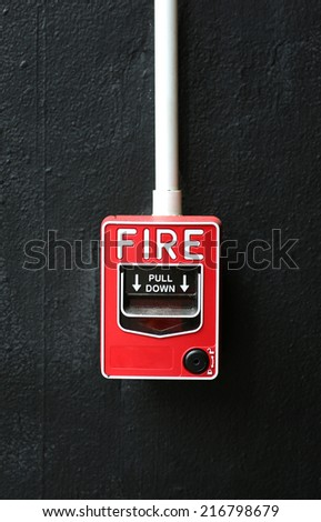 Fire alarm on black wall
