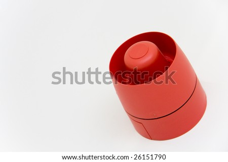 Fire alarm on white wall with copy space. - stock photo