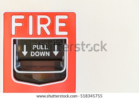 Fire alarm switch on white wall background