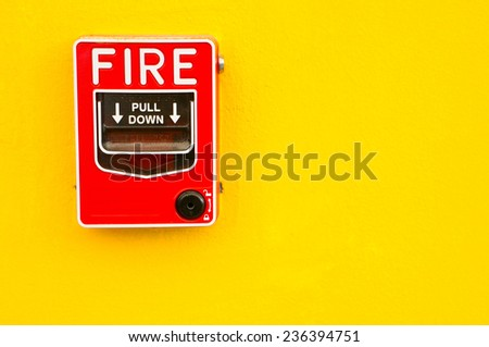 Fire alarm switch on yellow wall