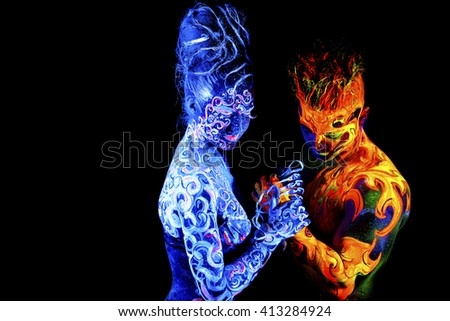 Four Elements Art : Fire air body art glowing ultraviolet stock photo royalty free