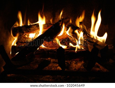 Fire and flames in a fireplace background - stock photo