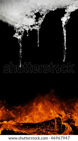 Fire and icicle on black background - stock photo