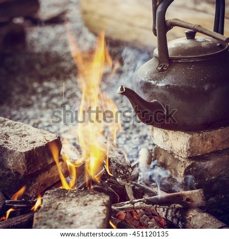 fire and kettle,vintage toned - stock photo