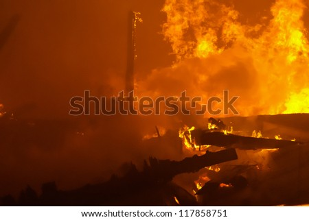 Fire and smoke after building destroyed by fire - stock photo