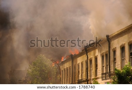 Fire and smoke in the city - stock photo