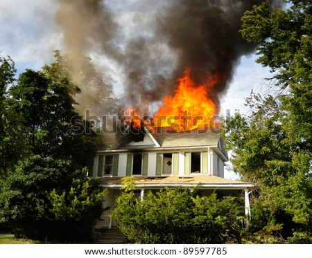 fire at suburban residence, fully involved - stock photo