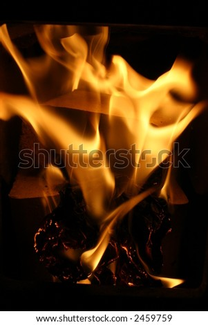 Fire background with Burning paper and firewood