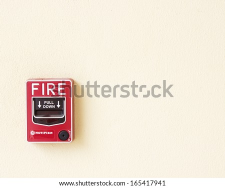 fire break glass alarm  switch on the wall - stock photo