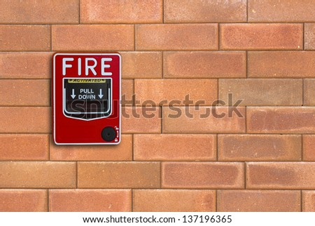 fire break glass on the brick wall background - stock photo