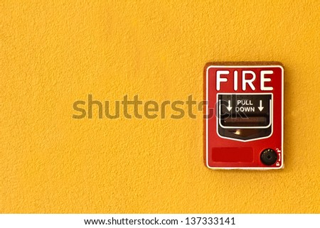fire break glass on wall - stock photo