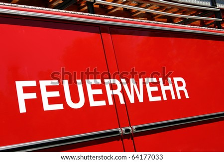 Fire brigade vehicle - in German language - stock photo