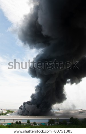 Fire burning and black smoke over cargo - stock photo