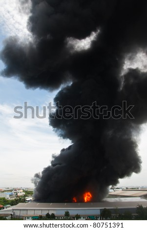 Fire burning and black smoke over cargo - stock photo