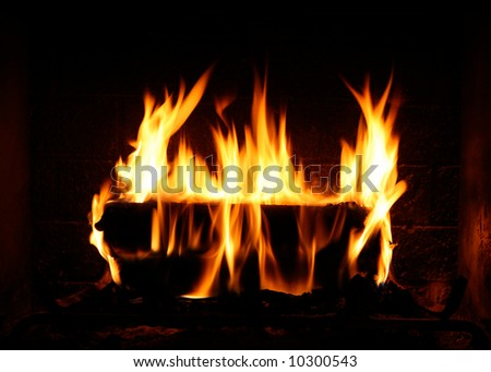 Fire Burning Brightly in a Wood-burning Fireplace - stock photo