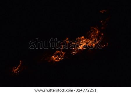 Fire. Burning of rice straw at night. - stock photo