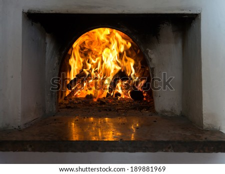 Fire burns in an old rural furnace