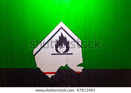 Fire danger symbol on a green texture railway carriage - stock photo