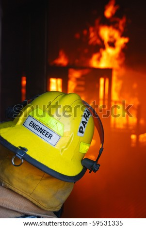 Fire Department crews attacking a gas fire in the mobile fire prop - stock photo