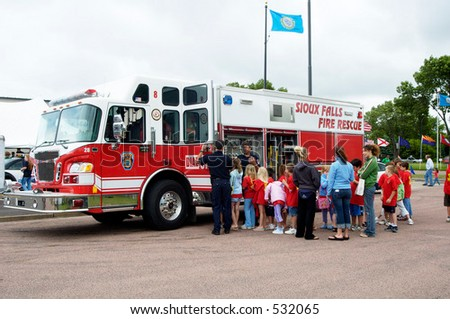 Fire department vehicle on display for school students.