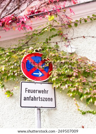fire driveway sign Germany (Feuerwehr anfahrtszone means fire driveway, no waiting, no parking) - stock photo