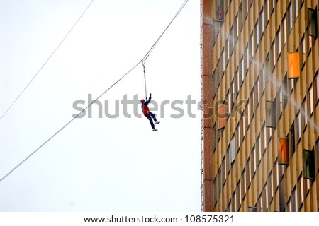 fire emergency services on the rope - stock photo